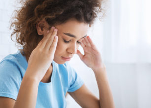 African-american woman suffering from headache